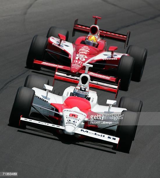 Sam Hornish Jr driver of the Marlboro Team Penske Dallara Honda ahead of Dan Wheldon driver of the Target Chip Ganassi Racing Dallara Honda and goes...