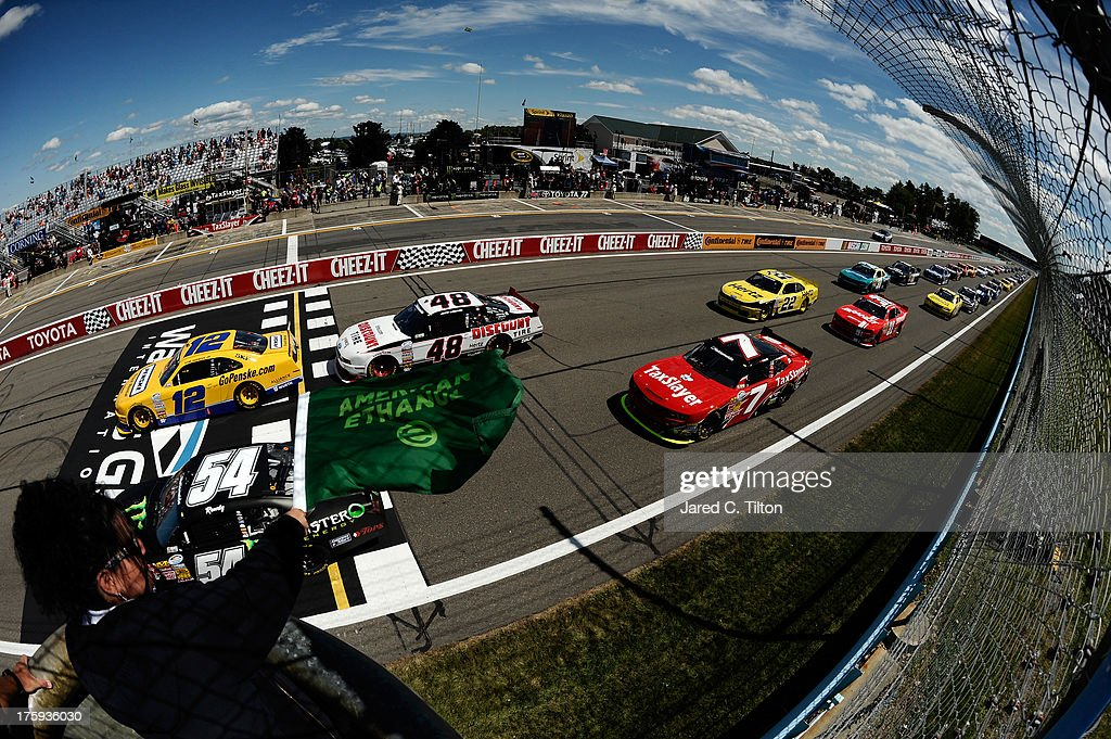 <a gi-track='captionPersonalityLinkClicked' href=/galleries/search?phrase=Sam+Hornish+Jr.&family=editorial&specificpeople=176571 ng-click='$event.stopPropagation()'>Sam Hornish Jr.</a>, driver of the #12 Penske Truck Rental Ford, leads the field at the start of the race during the NASCAR Nationwide Series Zippo 200 at Watkins Glen International on August 10, 2013 in Watkins Glen, New York.