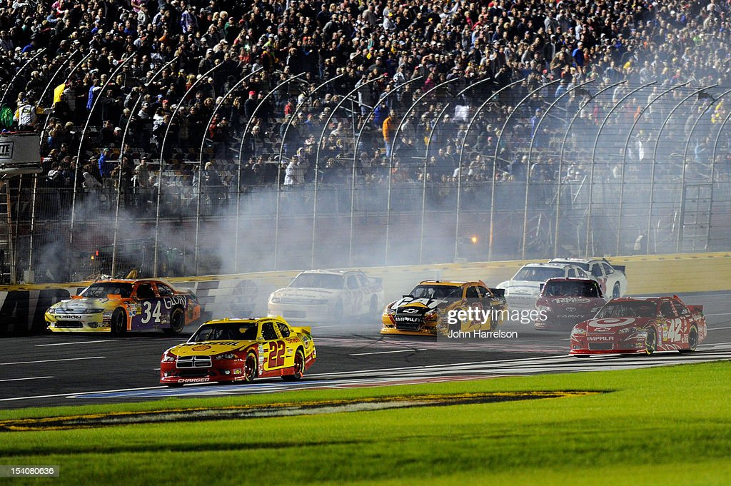 Sam Hornish Jr., driver of the #22 Shell/Pennzoil Dodge, David Ragan, driver of the #34 Glory Foods Ford, Timmy Hill, driver of the #32 U.S. Chrome Ford, Jeff Burton, driver of the #31 Caterpillar Chevrolet, Juan Pablo Montoya, driver of the #42 Target/Kellogg's Chevrolet, and Travis Kvapil, driver of the #93 Burger King/Dr Pepper Toyota, are involved in an incidetn during the NASCAR Sprint Cup Series Bank of America 500 at Charlotte Motor Speedway in Concord, North Carolina.