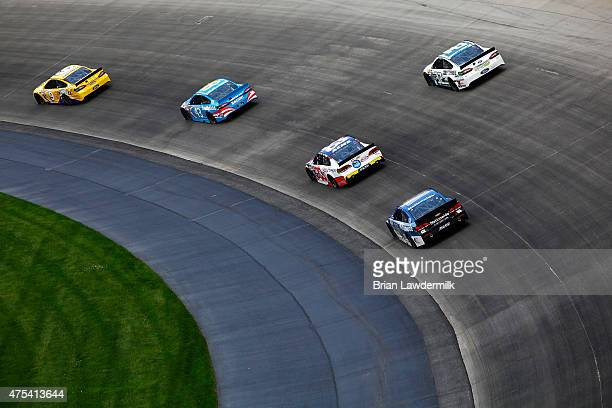 Sam Hornish Jr driver of the Twisted Tea Ford leads a pack of cars during the NASCAR Sprint Cup Series FedEx 400 Benefiting Autism Speaks at Dover...