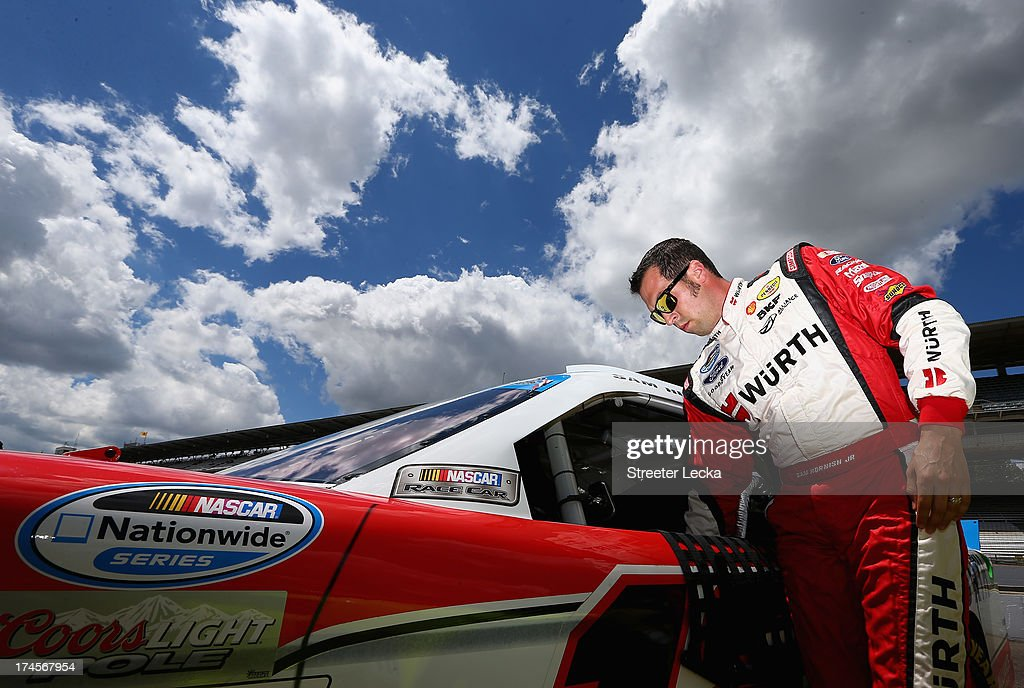 <a gi-track='captionPersonalityLinkClicked' href=/galleries/search?phrase=Sam+Hornish+Jr.&family=editorial&specificpeople=176571 ng-click='$event.stopPropagation()'>Sam Hornish Jr.</a>, driver of the #12 Wurth Ford, stands on the grid after qualifying for the NASCAR Nationwide Series Indiana 250 at Indianapolis Motor Speedway on July 27, 2013 in Indianapolis, Indiana.