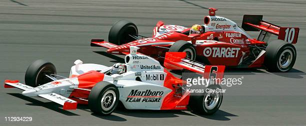 Sam Hornish Jr raced side by side with Dan Wheldon for several laps during the Kansas Lottery Indy 300 at the Kansas Speedway in Kansas City Missouri...