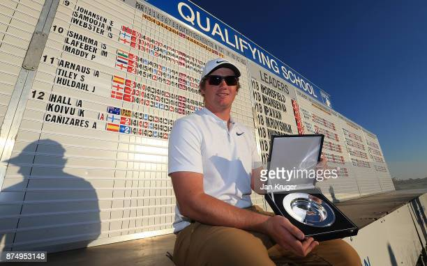 Sam Horsfield of England poses with his award after the final round of the European Tour Qualifying School Final Stage at Lumine Golf Club on...