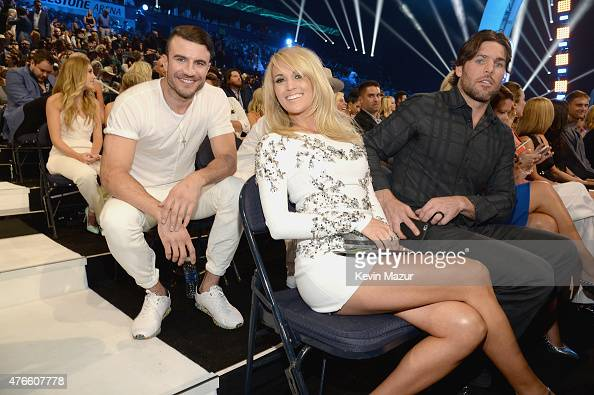 Sam Hunt Carrie Underwood and Mike Fisher attend the 2015 CMT Music awards at the Bridgestone Arena on June 10 2015 in Nashville Tennessee
