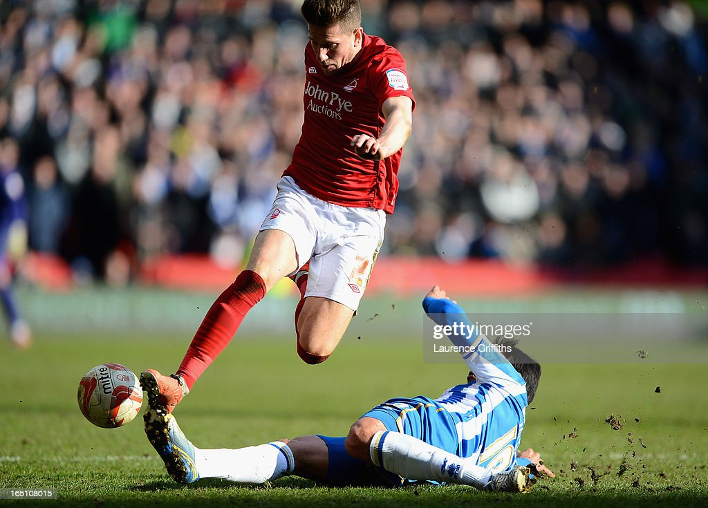 Sam Hutchinson of Nottingham Forest battles with Leonardo Ulloa of Brighton during the npower Championship match between Nottingham Forest and Brighton and Hove Albion at City Ground on March 30, 2013 in Nottingham, England.