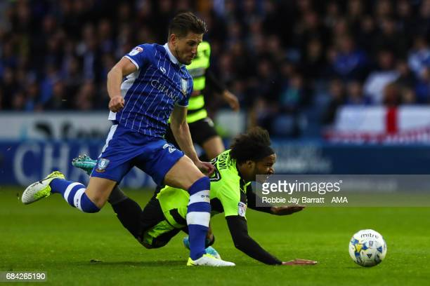 Sam Hutchinson of Sheffield Wednesday and Isaiah Brown of Huddersfield Town during the Sky Bet Championship match between Sheffield Wednesday and...