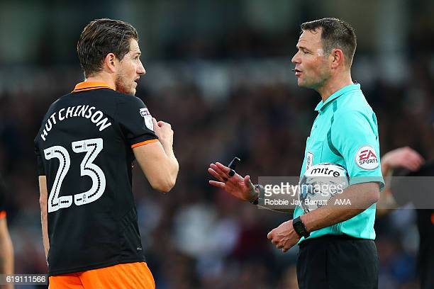 Sam Hutchinson of Sheffield Wednesday complains to referee James Linington during the Sky Bet Championship match between Derby County and Sheffield...