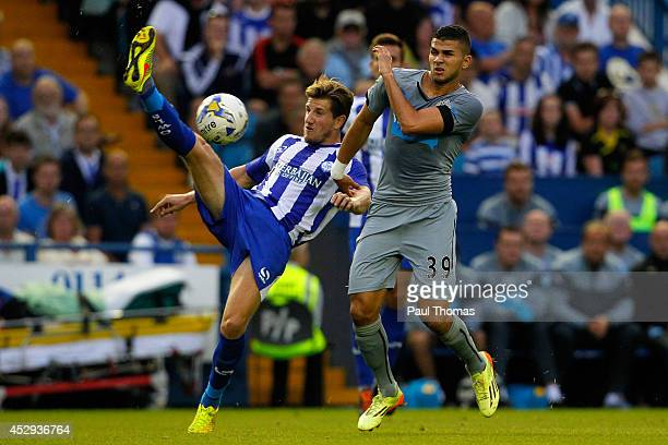 Sam Hutchinson of Sheffield Wednesday in action with Mehdi Abeid of Newcastle during the Pre Season Friendly between Sheffield Wednesday and...