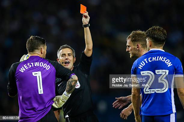 Sam Hutchinson of Sheffield Wednesday is given a red card during the Sky Bet Championship fixture between Sheffield Wednesday and Bristol City at...