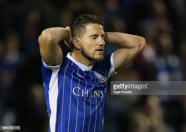 Sam Hutchinson of Sheffield Wednesday reacts after missing his sides first penalty during the Sky Bet Championship play off semi final second leg...
