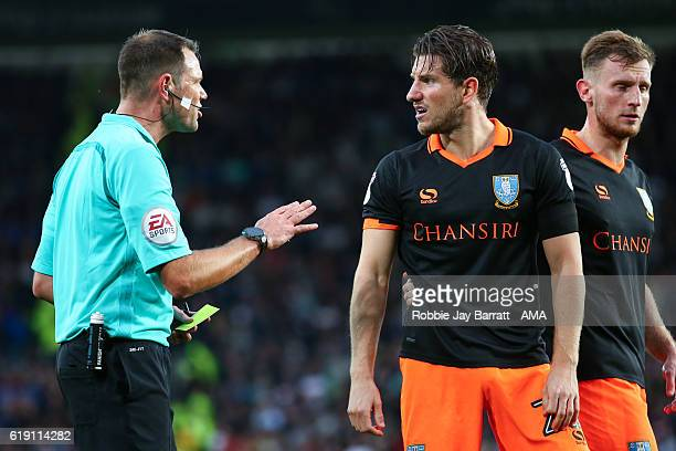 Sam Hutchinson of Sheffield Wednesday shows frustration to referee James Linington during the Sky Bet Championship match between Derby County and...
