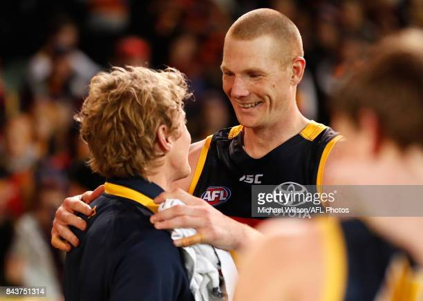 Sam Jacobs and Rory Sloane of the Crows embrace during the AFL First Qualifying Final match between the Adelaide Crows and the Greater Western Sydney...