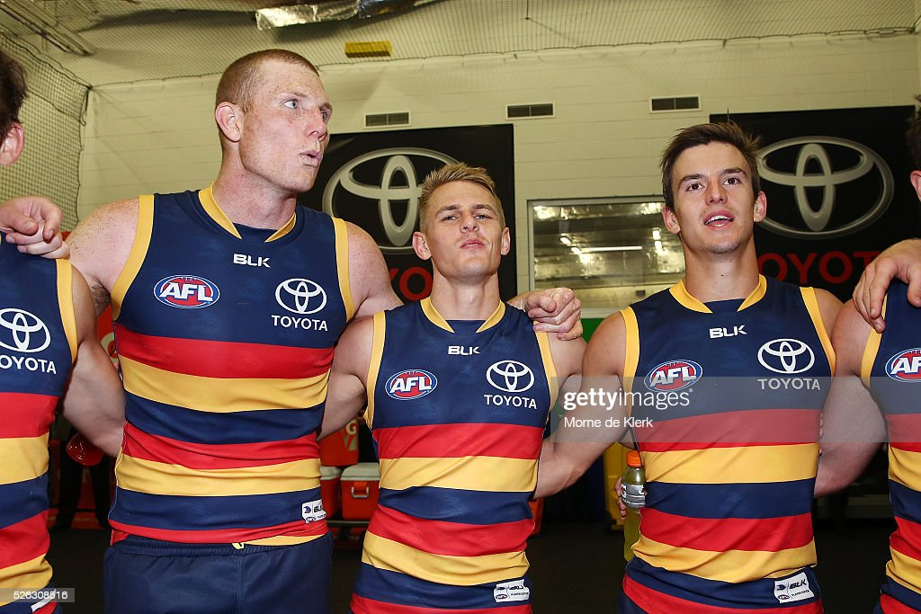 Sam Jacobs, David Mackay and Jarryd Lyons of the Crows celebrate in the rooms after the round six AFL match between the Adelaide Crows and the Fremantle Dockers at Adelaide Oval on April 30, 2016 in Adelaide, Australia.
