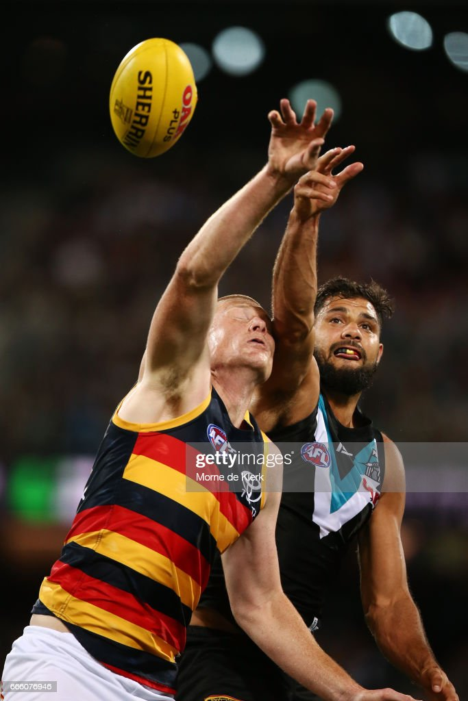 Sam Jacobs of the Crows and Paddy Ryder of the Power compete in the ruck during the round three AFL match between the Port Adelaide Power and the Adelaide Crows at Adelaide Oval on April 8, 2017 in Adelaide, Australia.
