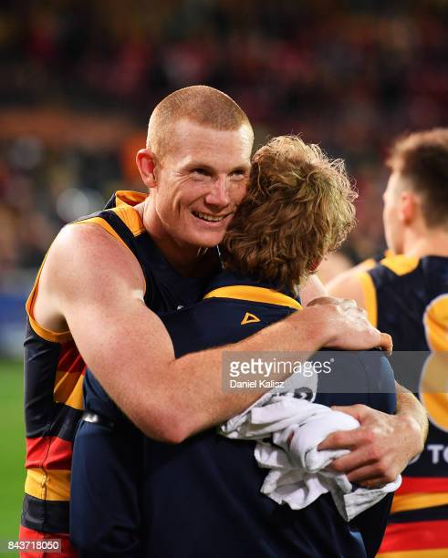 Sam Jacobs of the Crows and Rory Sloane of the Crows embrace after the AFL First Qualifying Final match between the Adelaide Crows and the Greater...