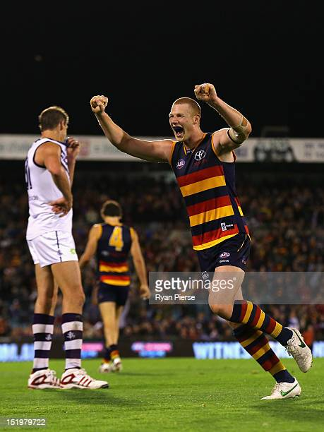 Sam Jacobs of the Crows celebrates on the final siren as Aaron Sandilands of the Dockers looks dejected during the AFL Second Semi Final match...