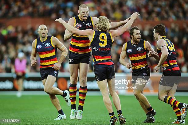 Sam Jacobs of the Crows celebrates with teammates after he kicked a goal during the round 15 AFL match between the Adelaide Crows and the Port...
