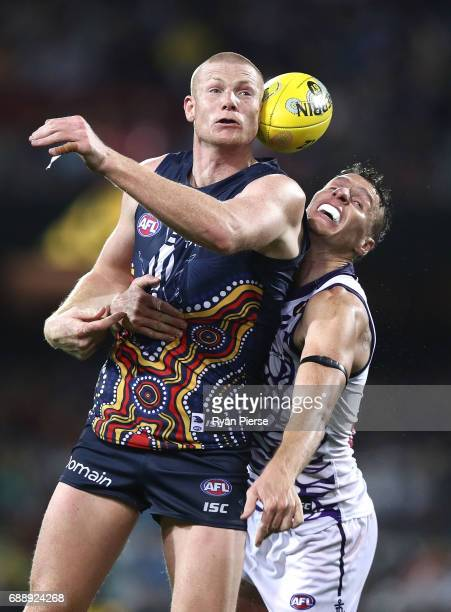 Sam Jacobs of the Crows competes for the ball against Jonathon Griffin of the Dockers during the round 10 AFL match between the Adelaide Crows and...