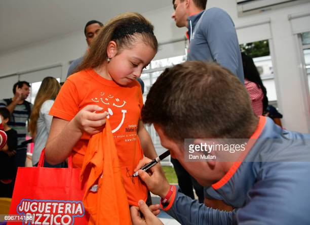 Sam James of England signs an autograph for a patient during a visit to Fundacion Mateo Esquivo a local children's cancer hospital on June 16 2017 in...