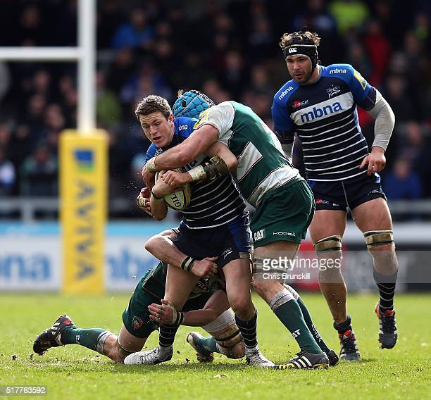 Sam James of Sale Sharks is tackled by Graham Kitchener of Leicester Tigers during the Aviva Premiership match between Sale Sharks and Leicester...