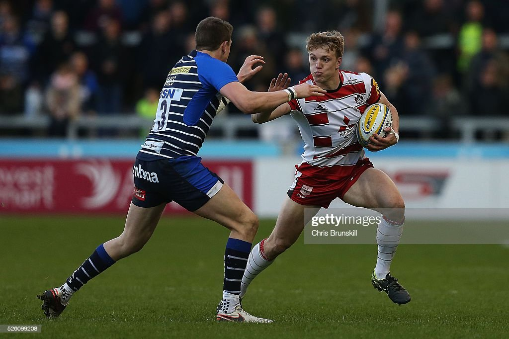 Sam James of Sale Sharks tackles Ollie Thorley of Gloucester Rugby during the Aviva Premiership match between Sale Sharks and Gloucester Rugby at the AJ Bell Stadium on April 29, 2016 in Salford, England.