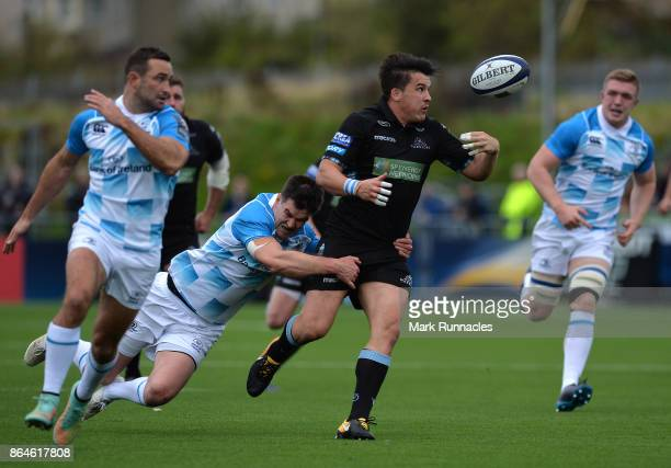 Sam Johnson of Glasgow Warriors is tackled by Johnny Sexton of Leinster Rugby during the European Rugby Champions Cup match between Glasgow Warriors...