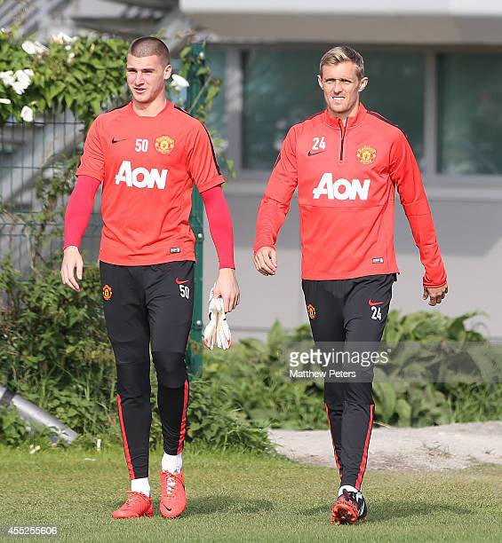 Sam Johnstone and Darren Fletcher of Manchester United in action during a first team training session at Aon Training Complex on September 11 2014 in...