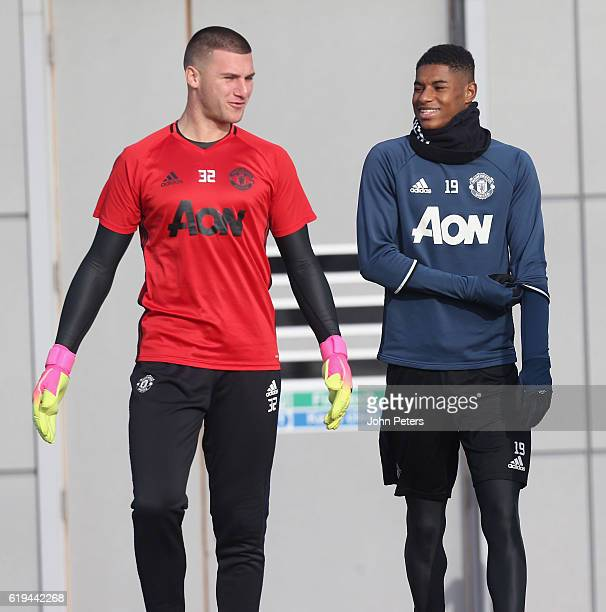 Sam Johnstone and Marcus Rashford of Manchester United in action during a first team training session at Aon Training Complex on October 31 2016 in...