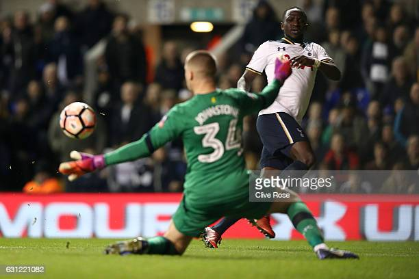 Sam Johnstone of Aston Villa saves a shot from Moussa Sissoko of Tottenham Hotspur during The Emirates FA Cup Third Round match between Tottenham...