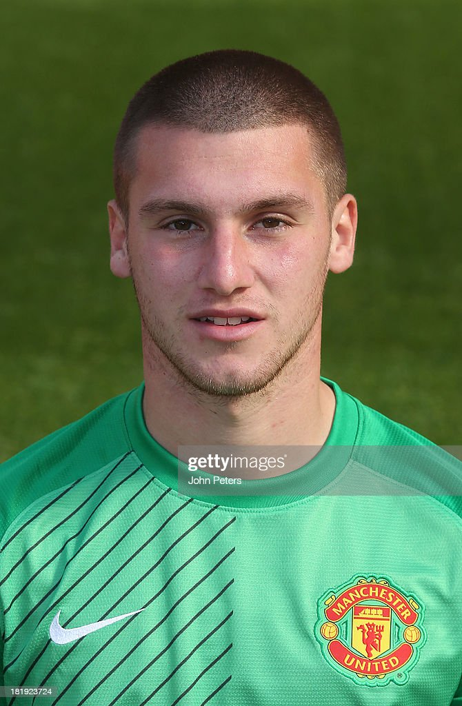 Sam Johnstone of Manchester United poses at the annual club photocall at Old Trafford on September 26, 2013 in Manchester, England.