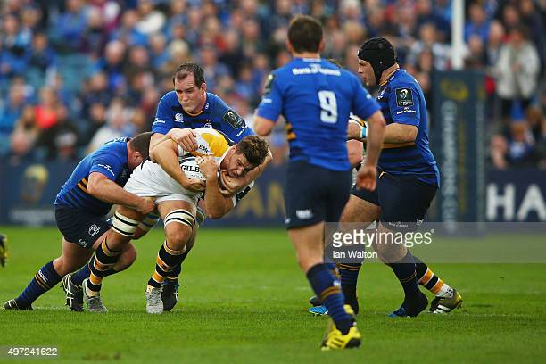 Sam Jones of Wasps is tackled by Devin Toner of Leinster during the European Rugby Champions Cup match between Leinster Rugby and Wasps at the RDS...