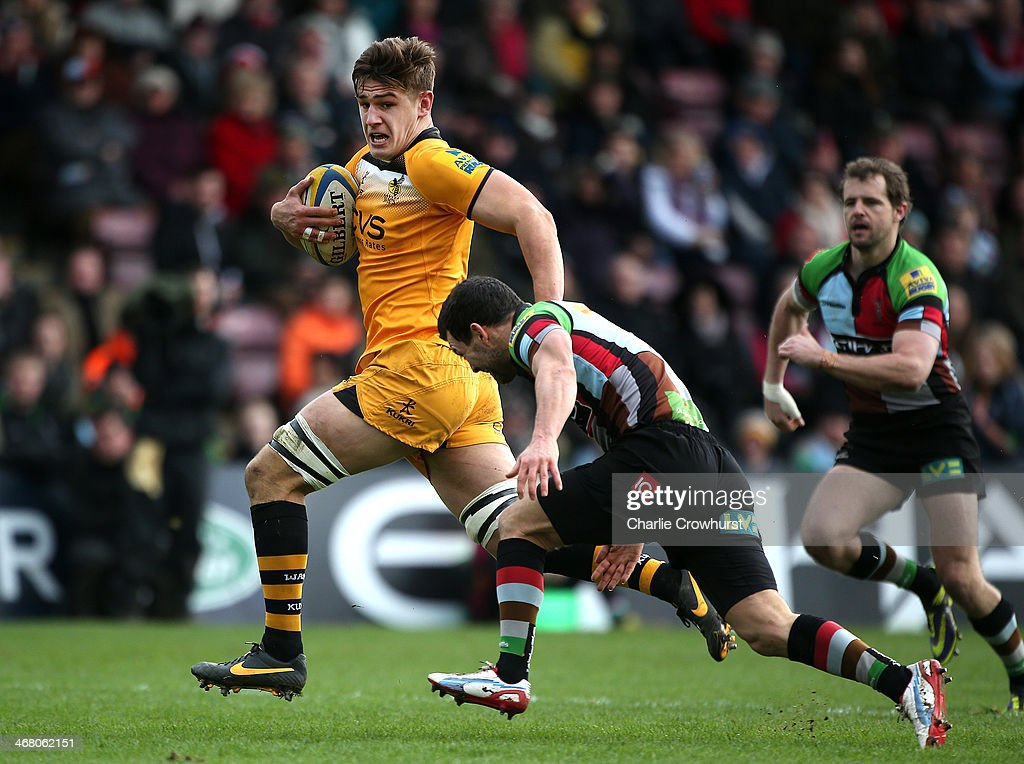 Sam Jones of Wasps is tackled by <a gi-track='captionPersonalityLinkClicked' href=/galleries/search?phrase=Karl+Dickson&family=editorial&specificpeople=693134 ng-click='$event.stopPropagation()'>Karl Dickson</a> of Harlequins during the Aviva Premiership match between Harlequins and London Wasps at Twickenham Stoop on Febuary 09, 2014 in London, England.