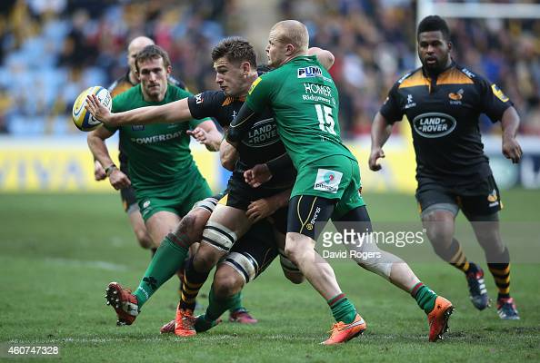 Sam Jones of Wasps off loads the ball as Tom Homer tackles during the Aviva Premiership match between Wasps and London Irish at the Ricoh Arena on...