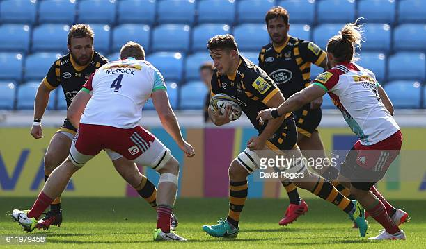 Sam Jones of Wasps takes on George Merrick during the Aviva Premiership match between Wasps and Harlequins at The Ricoh Arena on October 2 2016 in...