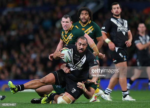 Sam Kasiano of New Zealand is tackled by Matthew Scott of Australia during the Rugby League World Cup Final between New Zealand and Australia at Old...