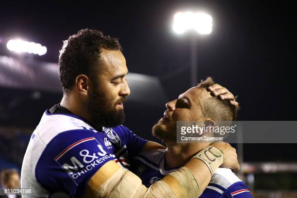 Sam Kasiano of the Bulldogs embraces team mate Josh Reynolds after winning the round 18 NRL match between the Canterbury Bulldogs and the Newcastle...