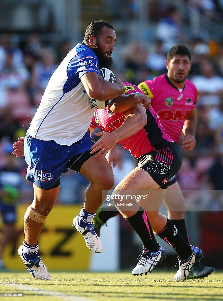 <a gi-track='captionPersonalityLinkClicked' href=/galleries/search?phrase=Sam+Kasiano&family=editorial&specificpeople=7554172 ng-click='$event.stopPropagation()'>Sam Kasiano</a> of the Bulldogs is tackled during the NRL Trial match between the Canterbury Bulldogs and the Penrith Panthers at Pepper Stadium on February 13, 2016 in Sydney, Australia.