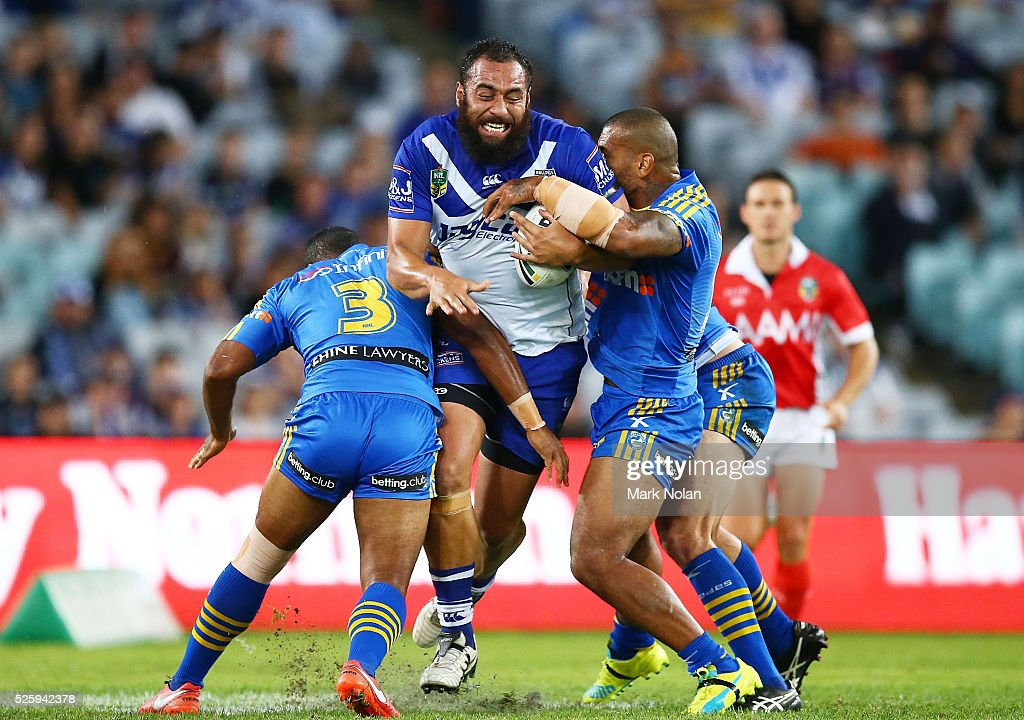 Sam Kasiano of the Bulldogs is tackled during the round nine NRL match between the Parramatta Eels and the Canterbury Bulldogs at ANZ Stadium on April 29, 2016 in Sydney, Australia.