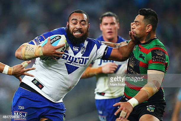 Sam Kasiano of the Bulldogs palms off John Sutton of the Rabbitohs during the round 24 NRL match between the South Sydney Rabbitohs and the...
