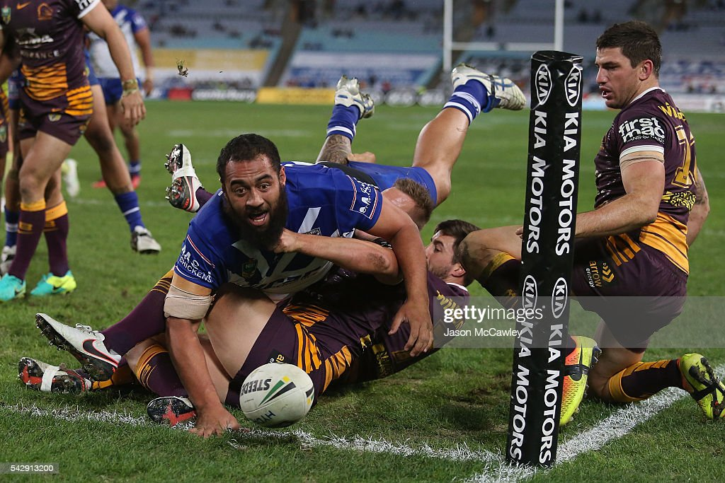 Sam Kasiano of the Bulldogs scores a try during the round 16 NRL match between the Canterbury Bulldogs and Brisbane Broncos at ANZ Stadium on June 25, 2016 in Sydney, Australia.