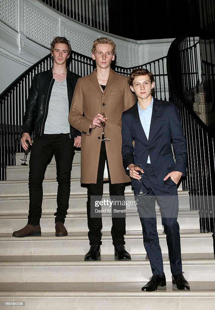 Sam Keeley, Edward Ashley and Breakthrough Brit Tom Holland attend the BAFTA 'Breakthrough Brits' event at Burberry 121 Regent Street, London on October 21, 2013 in London, United Kingdom.