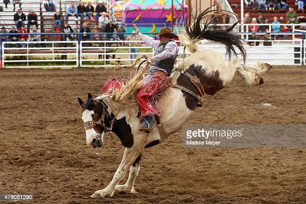 Sam Kelts of Millarville Alberta competes in the Saddle Bronc Riding competition during the 62nd Annual Wainwright Stampede on June 21 2015 in...