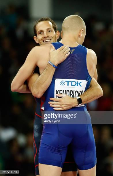 Sam Kendricks of the United States gold and Renaud Lavillenie of France bronze embrace as the compete in the Men's Pole Vault final during day five...