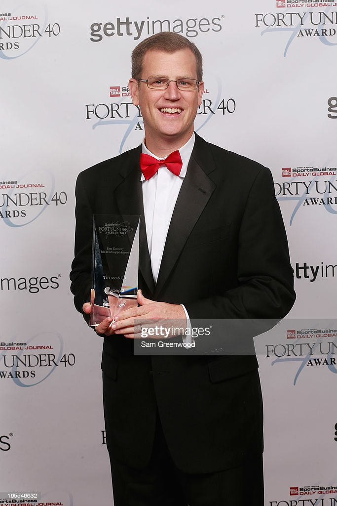 Sam Kennedy of the Boston Red Sox / Fenway Sports Management poses with award at the 2013 Forty Under 40 Awards on April 4, 2013 in Naples, Florida.