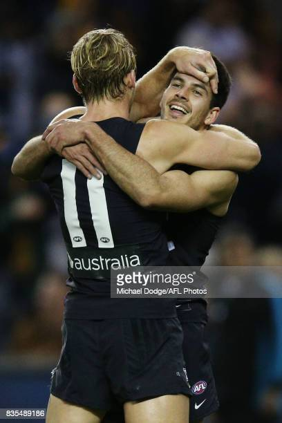 Sam Kerridge of the Blues and Blaine Boekhorst of the Blues celebrate the win during the round 22 AFL match between the Carlton Blues and the...