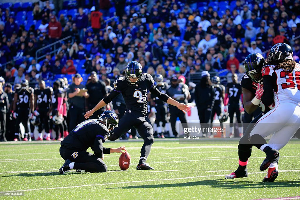 <a gi-track='captionPersonalityLinkClicked' href=/galleries/search?phrase=Sam+Koch&family=editorial&specificpeople=2106602 ng-click='$event.stopPropagation()'>Sam Koch</a> #4 holds as kicker Justin Tucker #9 of the Baltimore Ravens kicks a field goal against the Atlanta Falcons in the second half at M&T Bank Stadium on October 19, 2014 in Baltimore, Maryland.