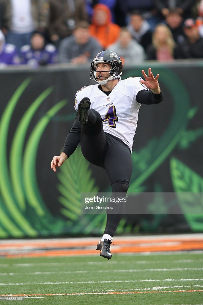 <a gi-track='captionPersonalityLinkClicked' href=/galleries/search?phrase=Sam+Koch&family=editorial&specificpeople=2106602 ng-click='$event.stopPropagation()'>Sam Koch</a> #4 of the Baltimore Ravens punts the football downfield during the game against the Cincinnati Bengals at Paul Brown Stadium on December 29, 2013 in Cincinnati, Ohio.