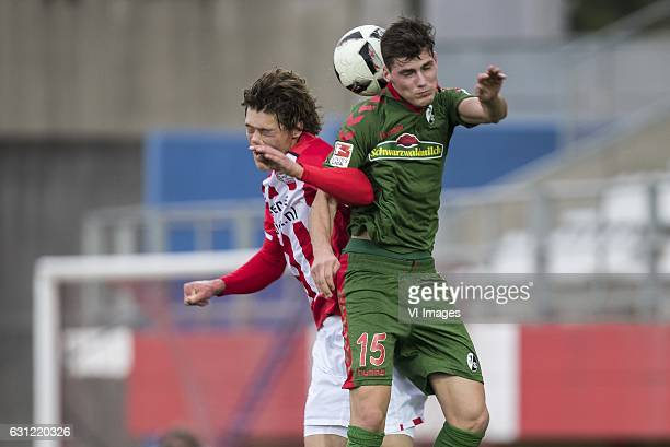Sam Lammers of PSV Pascal Stenzel of SC Freiburgduring the friendly match between PSV Eindhoven and SC Freiburg at the stadium Nuevo Mirador on...