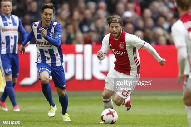 Sam Larsson of sc Heerenveen Yuki Kobayashi of sc Heerenveen Lasse Schone of Ajaxduring the Dutch Eredivisie match between Ajax Amsterdam and sc...
