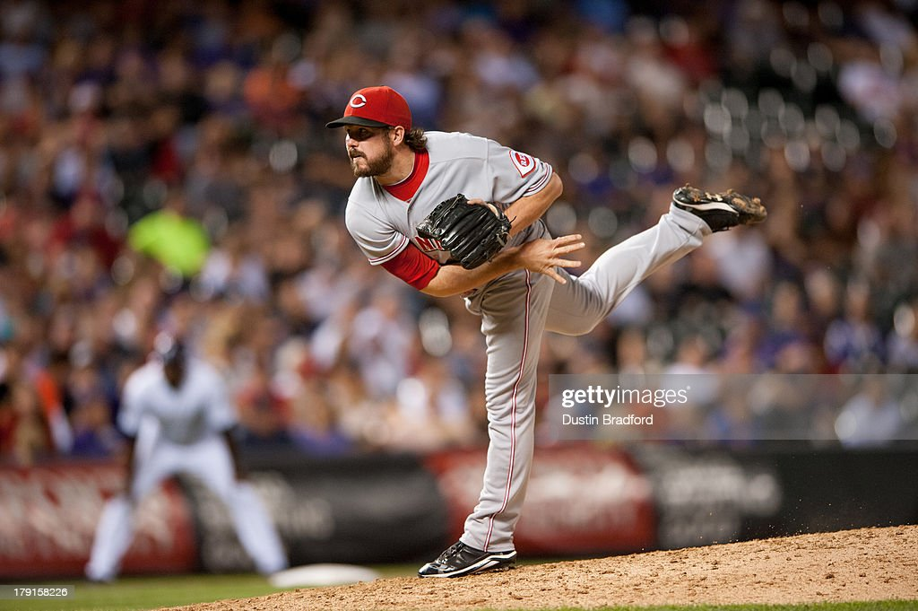 <a gi-track='captionPersonalityLinkClicked' href=/galleries/search?phrase=Sam+LeCure&family=editorial&specificpeople=5745610 ng-click='$event.stopPropagation()'>Sam LeCure</a> #63 of the Cincinnati Reds pitches in the ninth inning of a game against the Colorado Rockies at Coors Field on August 31, 2013 in Denver, Colorado. The Reds beat the Rockies 8-3.